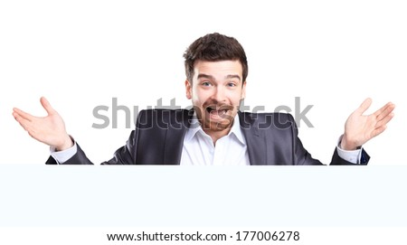 Happy business man man with shocked facial expression presenting and showing with copy space for your text isolated on white background  - stock photo