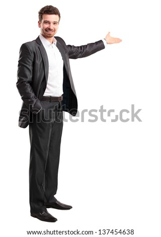 Happy business man presenting and showing with copy space for your text isolated on white background - stock photo