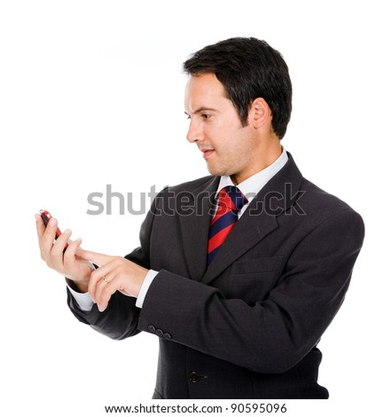 Happy business man reading an SMS on cellphone against white