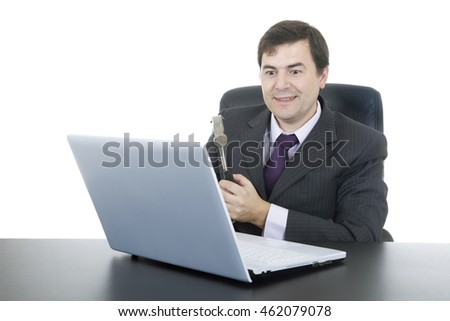 happy business man with a hammer smashing a laptop, isolated