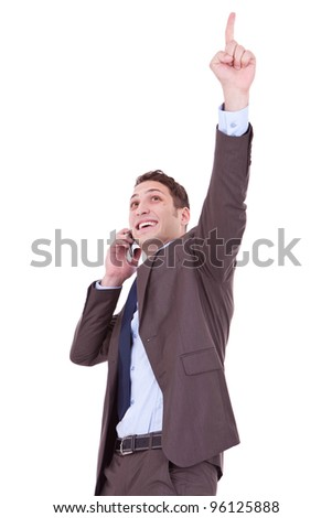 happy business man with cellular phone winning over white background