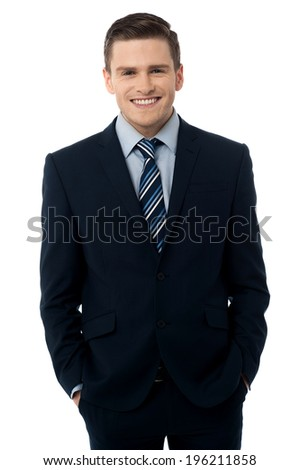 Happy business man with his hands in the pockets - stock photo