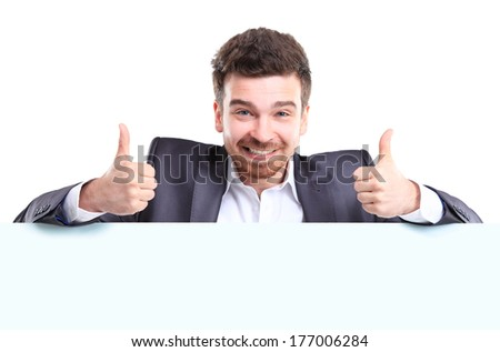 Happy business man with thumbs up gesture presenting and showing with copy space for your text isolated on white background  - stock photo