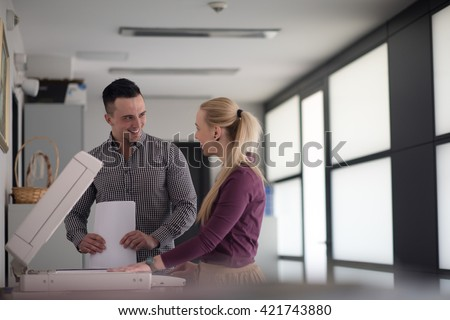 happy business people group at modern office copy  documents on machine - stock photo