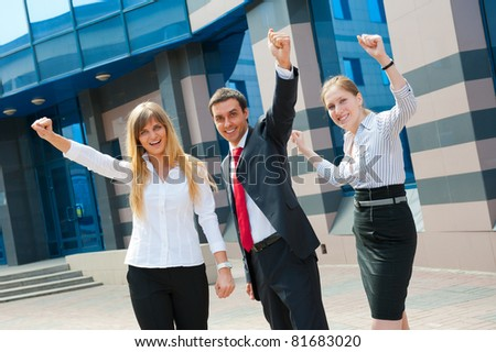 Happy business people group in modern downtown - stock photo