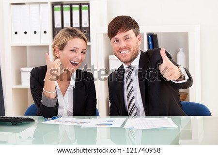 Happy business people in office celebrating success - stock photo