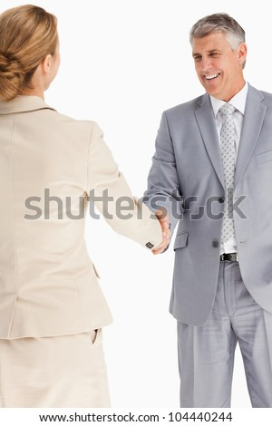 Happy business people shaking hands against white background - stock photo