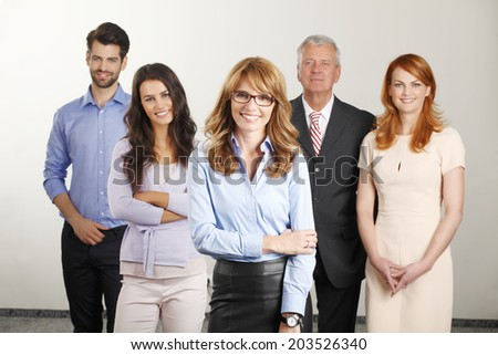 Happy business people standing. Business group.  - stock photo