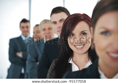 Happy business people standing together - stock photo