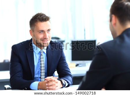 Happy business people talking on meeting at office - stock photo