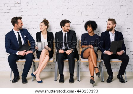 Happy business people waiting for job interview - stock photo