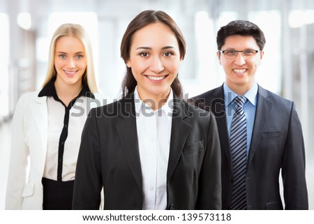 Happy business people with their female leader on the foreground