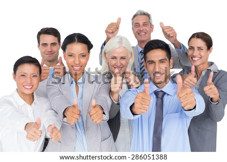 Happy business people with thumbs up looking at camera - stock photo