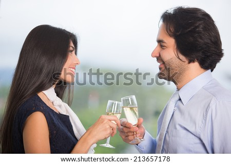 Happy business team celebrating  with wine glass in office