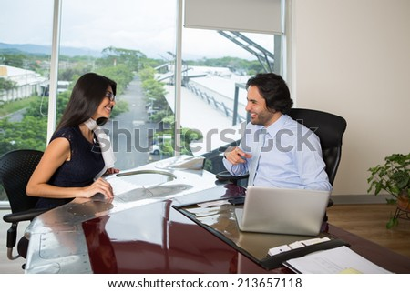 Happy business team during a brainstorming in office - stock photo