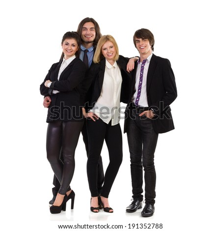 Happy business team. Four young elegance people standing together and smile. Full length studio shot isolated on white.