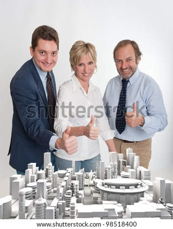 Happy business team in front of a project