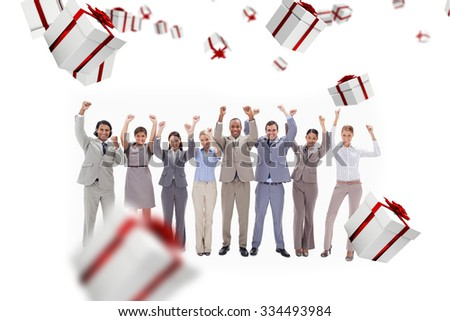 Happy business team raising their arms against white and red gift box - stock photo