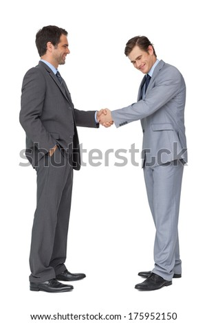 Happy business team shaking hands on white background - stock photo