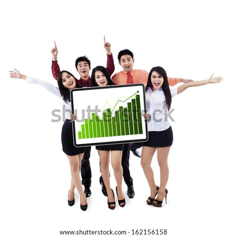 Happy business team showing a growing graph isolated on white background - stock photo