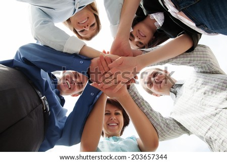 Happy business team showing unity - stock photo