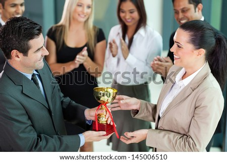 happy business team winning a trophy - stock photo
