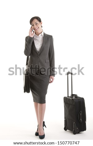 Happy business traveller eon the phone