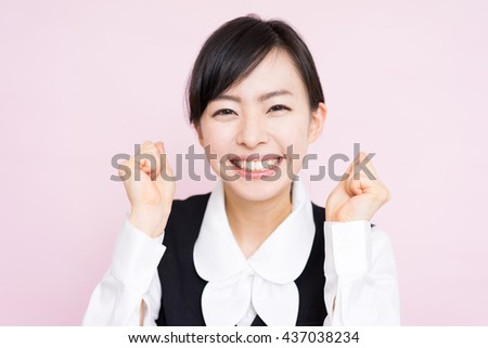 Happy business woman against pink background - stock photo