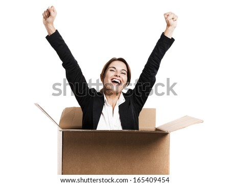 Happy business woman appear inside a big card box, isolated over white background - stock photo