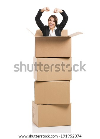 Happy business woman appear inside big card boxes, isolated over white background - stock photo
