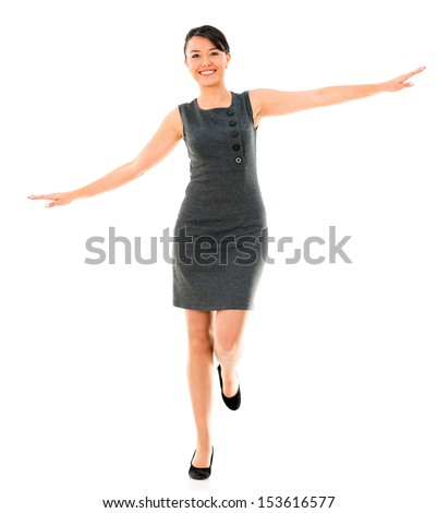 Happy business woman balancing - isolated over a white background