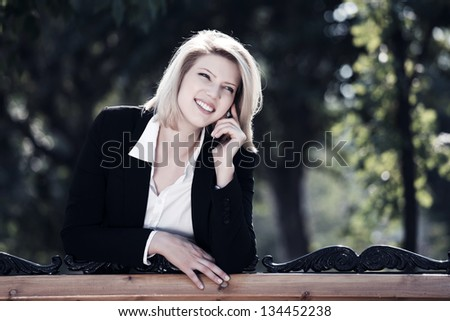 Happy business woman calling on the phone - stock photo