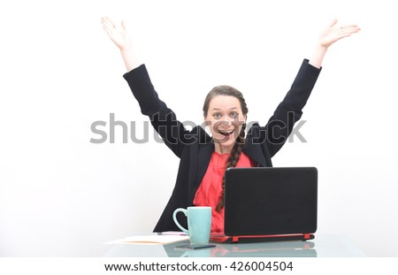 Happy business woman celebrating success with hands raised in the air - stock photo