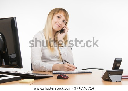 Happy business woman flirts talking on a mobile phone