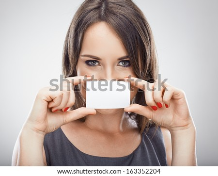 Happy business woman hold credit card. Isolated white background. - stock photo