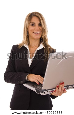 Happy business woman holding a computer - isolated on white
