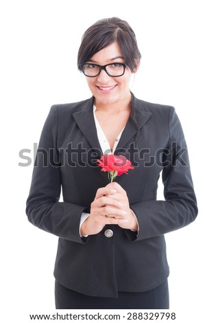 Happy business woman holding a flower feeling excited, surprised and loved - stock photo