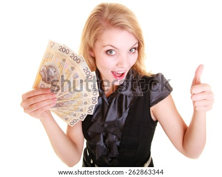 Happy business woman holding polish currency money banknote giving thumb up hand sign gesture. Finance and success.
