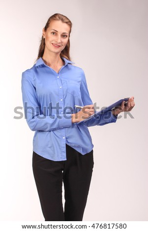 Happy business woman holds tablet with abstract graphics, isolated on white background