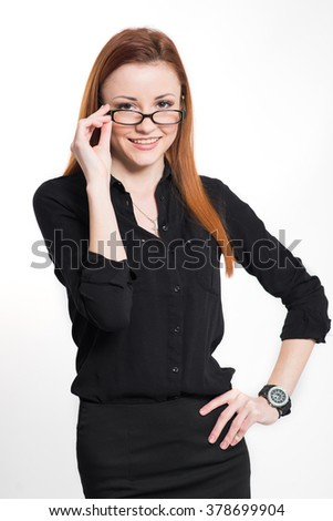 Happy business woman in black with glasses over the white background