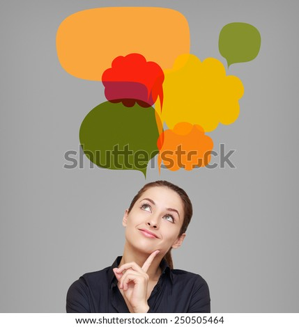 Happy business woman looking on many bright colorful bubbles. Creative chart design on grey background - stock photo
