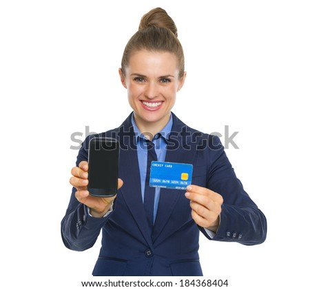 Happy business woman showing credit card and phone