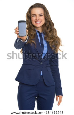Happy business woman showing phone