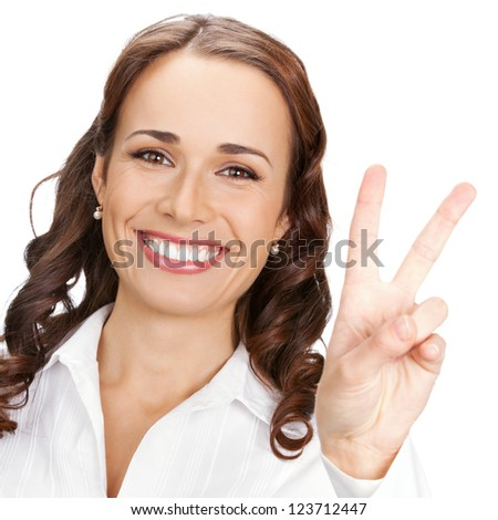 Happy business woman showing two fingers or victory gesture, isolated over white background