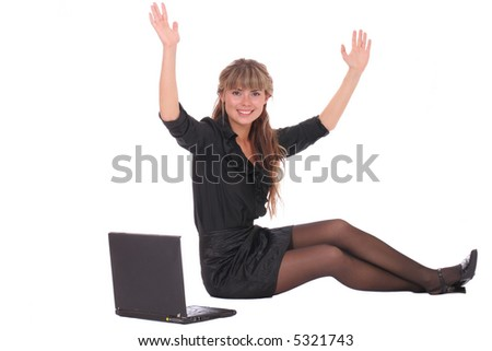 Happy business woman sitting with laptop and  put her hands  in the air
