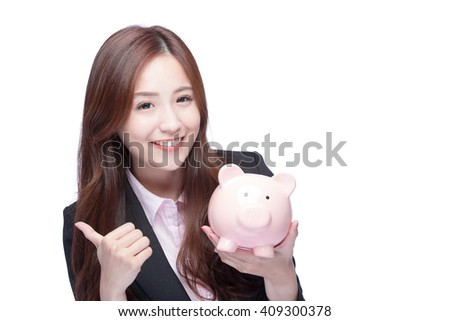 Happy business woman smiling holding pink piggy bank and show thumb up isolated on white background. Asian girl