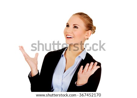 Happy business woman trying to catch something - stock photo