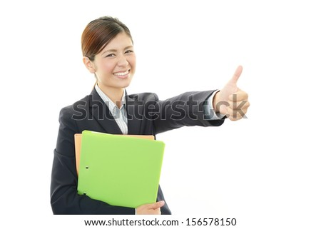 Happy business woman with thumbs up - stock photo