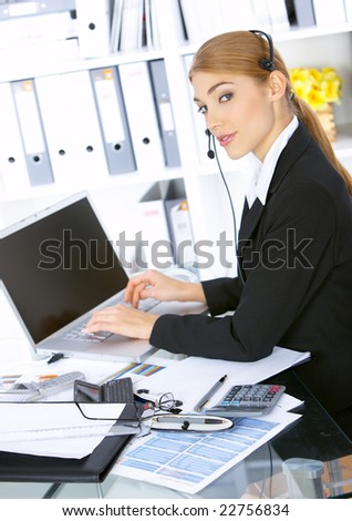 Happy Business woman working in office, wearing headset