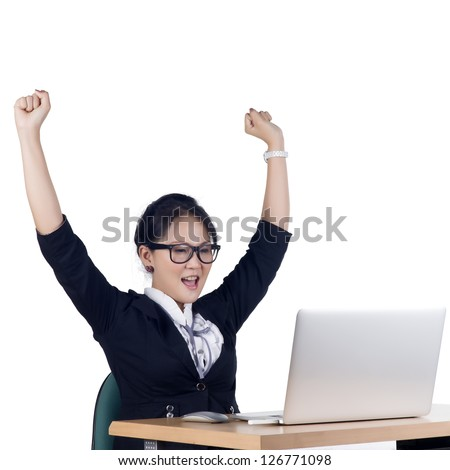 Happy business woman working on a laptop at the office. Isolated white background. Model is Asian woman. - stock photo